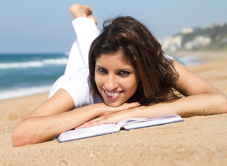 beautiful woman reading on beach photo