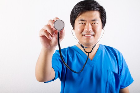 male nurse holding stethoscope photo