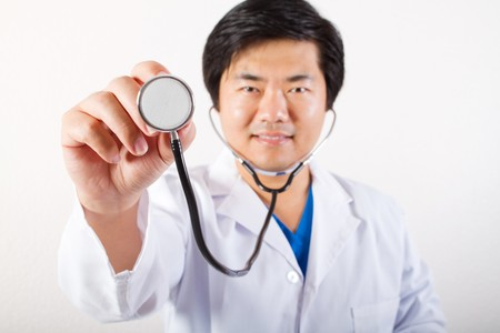 young asian doctor holding stethoscope photo