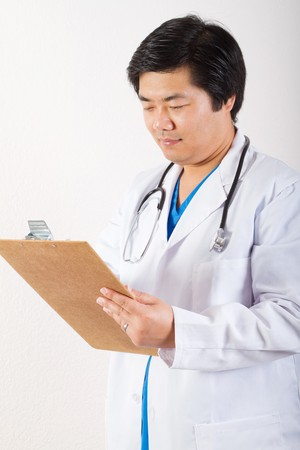 asian doctor checking clipboard photo