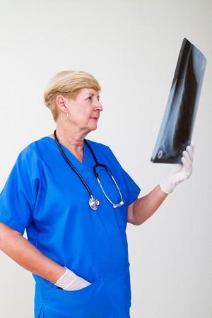 senior doctor looking at x-ray  photo