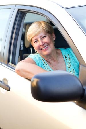 senior woman in car photo