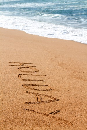 holiday - written on sand on beach photo