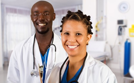 medical physician: happy african doctor and nurse in hospital ward