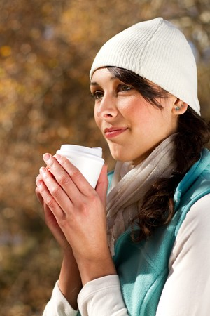 attractive woman drinking coffee in autumn forest Stock Photo - 7277233