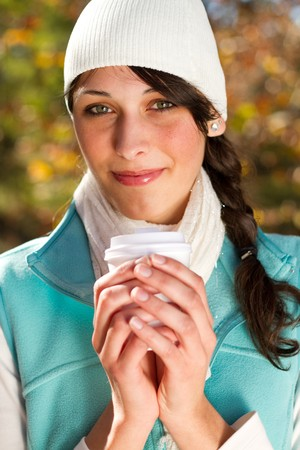 attractive woman drinking coffee in autumn forest Stock Photo - 7277235