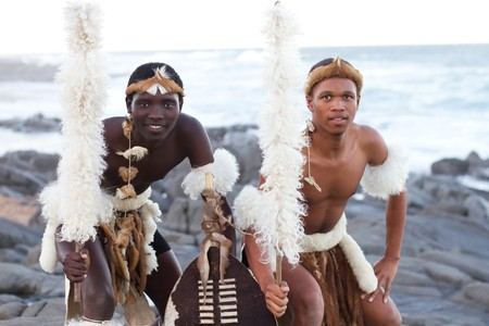 african warriors: african zulu man posing on beach Stock Photo