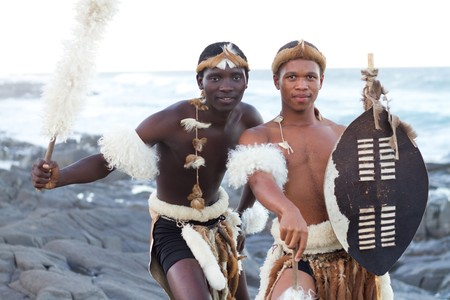 african warriors: african zulu men on beach Stock Photo