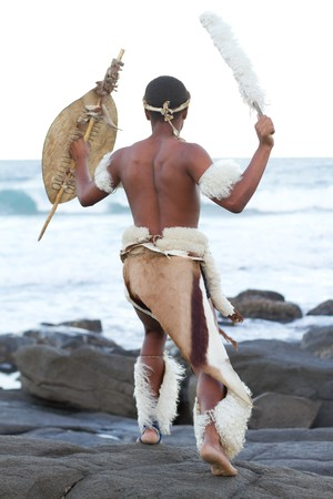 african warriors: african man dressing in traditional clothes on beach Stock Photo