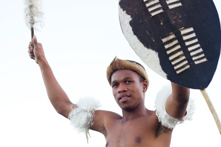 african zulu man holding traditional shield photo