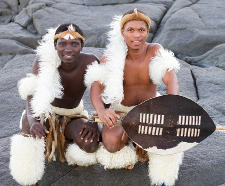 traditional african men on beach photo