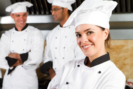 service occupation: young beautiful professional chefs portrait Stock Photo