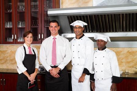 hotel staff: restaurant staff inside industrial kitchen Stock Photo