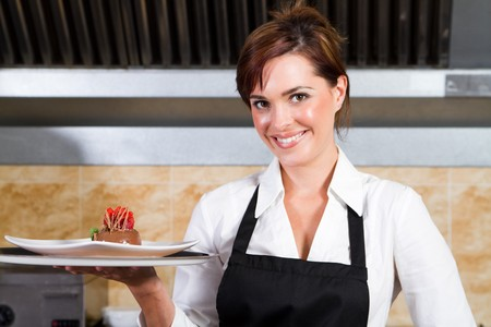 waitress holding plate of dessert photo