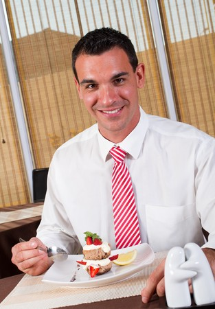 middle aged man eating dessert photo