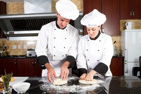 chefs kneading bread dough  photo