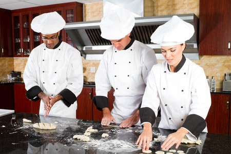 preparations: professional chefs in kitchen Stock Photo