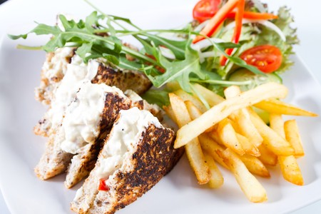toasted sandwich: toasted sandwich with chips and salad