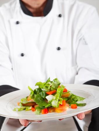 happy senior chef presenting salad Stock Photo - 7453925
