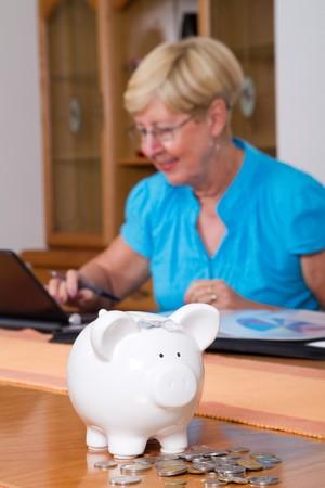 senior woman working on home finances photo