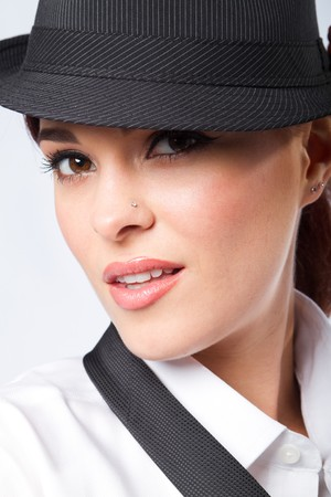 close-up of beautiful woman in mans hat  photo