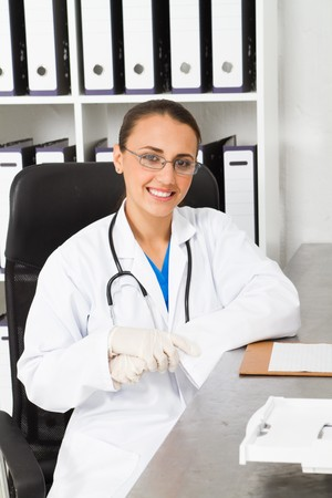 gloves nurse: young medical nurse in office Stock Photo