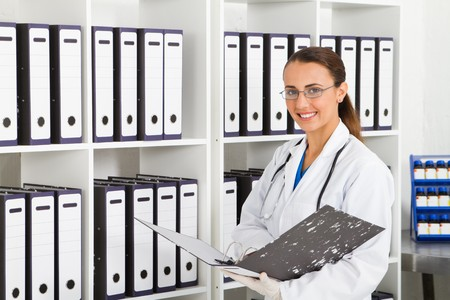 medical gloves: intern searching for information in office Stock Photo