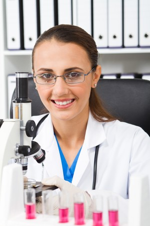 young science student using microscope Stock Photo - 7517040
