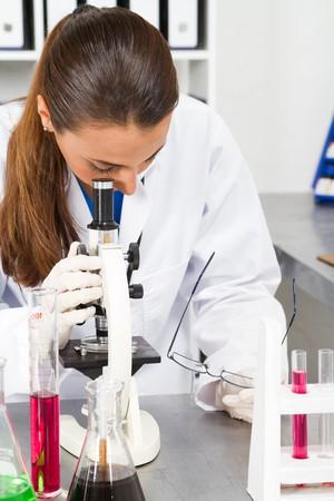 white glove test: female scientist in lab