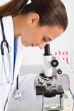 female medical researcher using microscope Stock Photo - 7517056