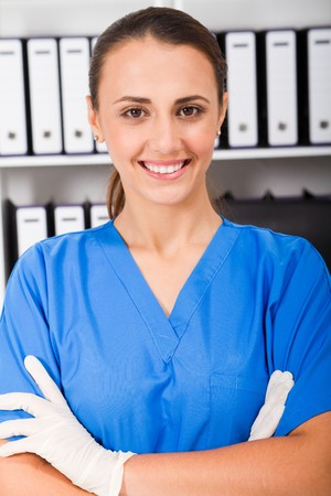 nurse gloves: young nurse in office Stock Photo