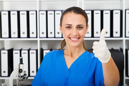 female medical researcher thumbs up photo