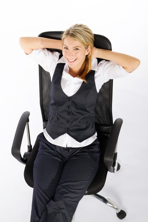 businesswoman relaxing in chair photo