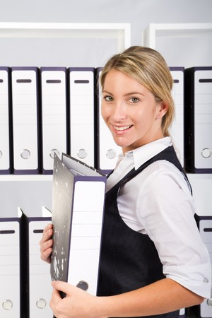 happy business woman in office with files Stock Photo