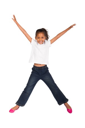 leaping: happy indian girl jumping on white background Stock Photo