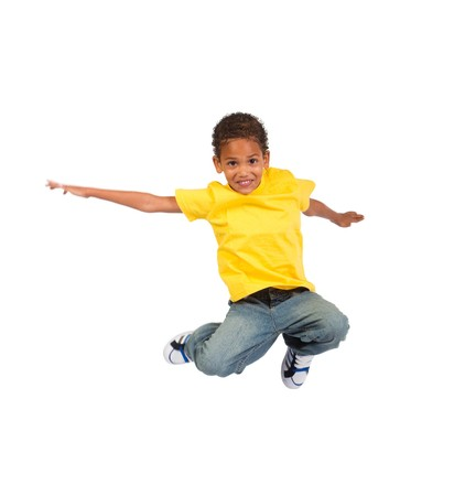 child model: active african boy jumping Stock Photo