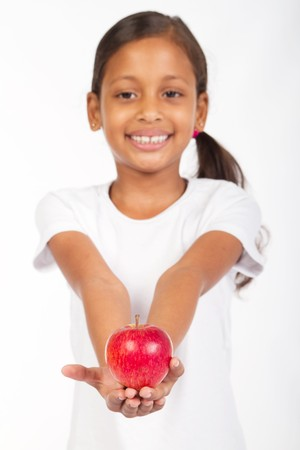 sweet indian girl holding apple photo