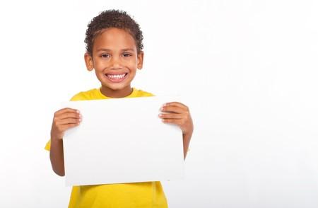 indian boy holding white board photo