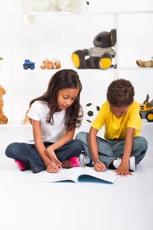colored play: happy african american kids coloring in together