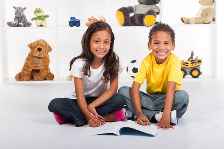 indian children: happy african american kids coloring in together