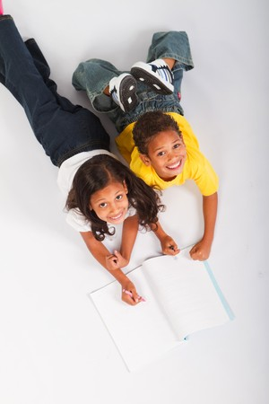 overhead of happy kids coloring in together photo