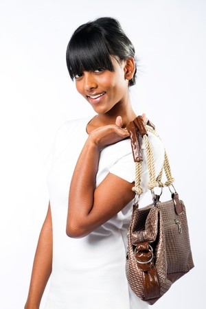 pretty indian girl holding handbag photo