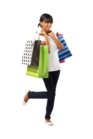 happy shopping indian girl on white background Stock Photo - 7586041