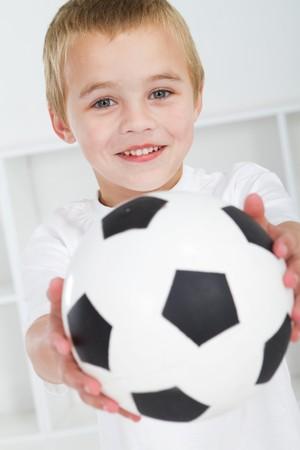 sweet boy holding soccer ball photo