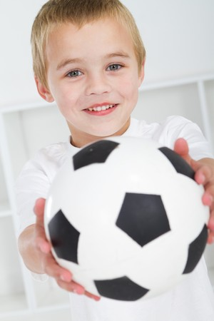 indoor soccer: sweet boy holding soccer ball