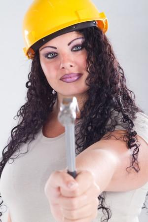 female plus size model wearing construction hat photo