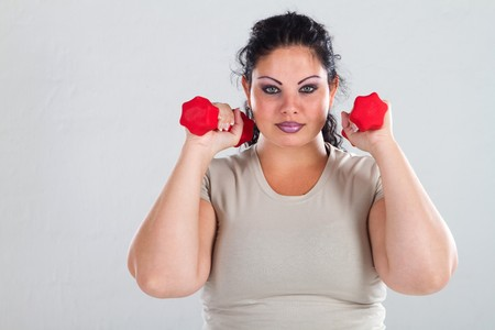 overweight woman lifting weights photo