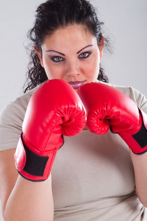 woman boxing gloves: overweight woman wearing boxing gloves
