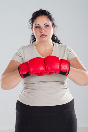 box size: overweight woman wearing boxing gloves