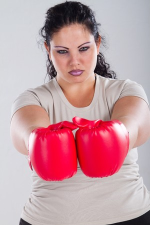 overweight woman wearing boxing gloves photo